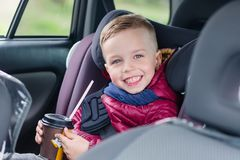 Adorable toddler boy in safety car seat Stock Photography
