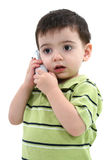 Adorable Toddler Boy Speaking On A Cordless Phone Over White Royalty Free Stock Images