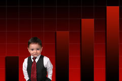 Adorable Toddler Boy In Suit Standing Against Bar Graph