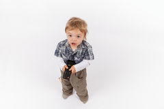 Adorable toddler boy with a tv remote control Royalty Free Stock Photo