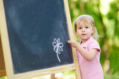 Adorable toddler drawing with a chalk Royalty Free Stock Image