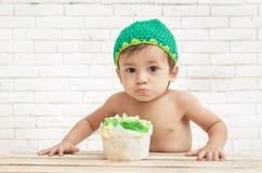 Adorable toddler eating sponge cake Stock Images