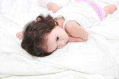Adorable toddler girl. On the bed at home Royalty Free Stock Images
