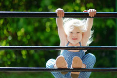 Adorable toddler girl acting like a monkey Royalty Free Stock Photos