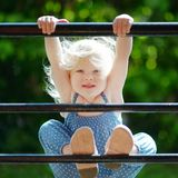 Adorable toddler girl acting like a monkey Royalty Free Stock Photo
