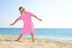 Adorable toddler girl at beach Stock Images