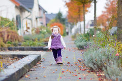 Adorable toddler girl on beautiful road of small village Royalty Free Stock Image