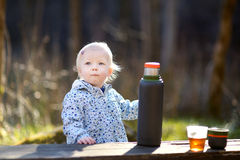 Adorable toddler girl camping Stock Image