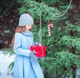 Adorable toddler girl with christmas box gift in Stock Photos