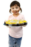 Adorable Toddler Girl with Cupcakes stock photography