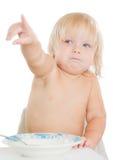 Adorable toddler girl eat porridge Stock Images