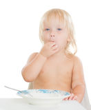 Adorable toddler girl eat porridge Royalty Free Stock Images