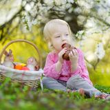 Adorable toddler girl eating chocolate bunny Royalty Free Stock Photo