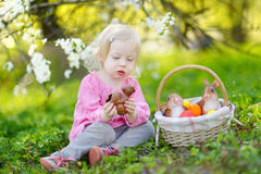 Adorable toddler girl eating chocolate bunny Royalty Free Stock Images