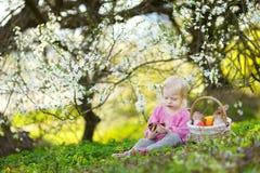 Adorable toddler girl eating chocolate bunny Stock Image
