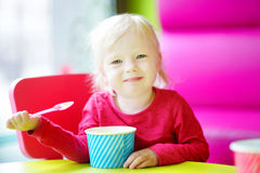 Adorable toddler girl eating ice cream Royalty Free Stock Photography