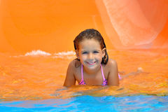 Adorable toddler girl enjoying her summer vacation at aquapark Stock Images