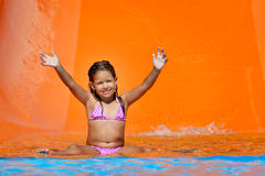 Adorable toddler girl enjoying her summer vacation at aquapark Royalty Free Stock Image