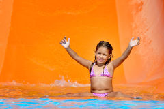 Adorable toddler girl enjoying her summer vacation at aquapark Stock Image