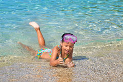 Adorable toddler girl enjoying her summer vacation at beach Royalty Free Stock Photos