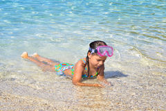 Adorable toddler girl enjoying her summer vacation at beach Stock Image