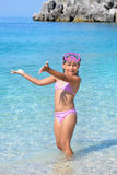 Adorable toddler girl enjoying her summer vacation at beach Stock Images