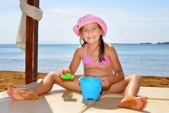 Adorable toddler girl enjoying her summer vacation at beach Royalty Free Stock Photos