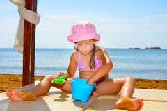 Adorable toddler girl enjoying her summer vacation at beach Stock Photography