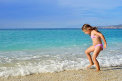Adorable toddler girl enjoying her summer vacation at beach Royalty Free Stock Photography