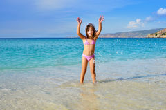 Adorable toddler girl enjoying her summer vacation at beach Royalty Free Stock Images