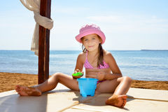 Adorable toddler girl enjoying her summer vacation at beach Stock Photo
