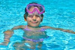 Adorable toddler girl enjoying her summer vacation at swimming p Royalty Free Stock Photos