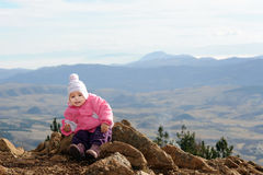 Adorable toddler girl enjoying at mountain Royalty Free Stock Images