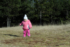 Adorable toddler girl enjoying at mountain Stock Image
