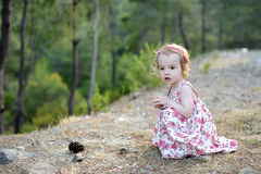 Adorable toddler girl in a floral dress Royalty Free Stock Image