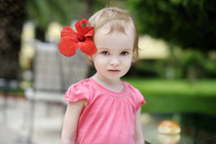 Adorable toddler girl with a hibiscus Royalty Free Stock Photography