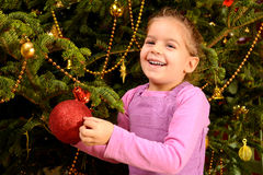 Adorable toddler girl holding decorative Christmas toy ball Stock Image