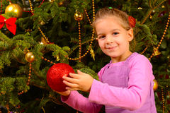 Adorable toddler girl holding decorative Christmas toy ball Royalty Free Stock Photography