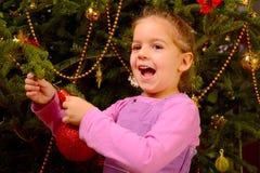 Adorable toddler girl holding decorative Christmas toy ball Royalty Free Stock Photos