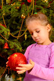 Adorable toddler girl holding decorative Christmas toy ball Royalty Free Stock Images