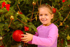 Adorable toddler girl holding decorative Christmas toy ball Stock Photography