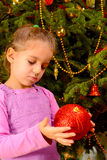Adorable toddler girl holding decorative Christmas toy ball Royalty Free Stock Photos