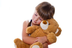 Adorable toddler girl hugging a teddy bear Royalty Free Stock Photography