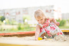 Adorable Toddler Girl In Dress Play With Sand Stock Photography