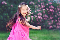Adorable toddler girl little girl having fun outdoors and dancin Royalty Free Stock Photography