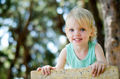 Adorable toddler girl looking right in camera shallow focus Stock Image