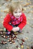 Adorable toddler girl outdoors on autumn day Stock Photo