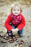 Adorable toddler girl outdoors on autumn day Stock Photography