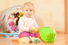 Adorable toddler girl play with bucket on floor Stock Images