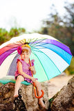 Adorable toddler girl playing outdoors in green summer park Royalty Free Stock Photo